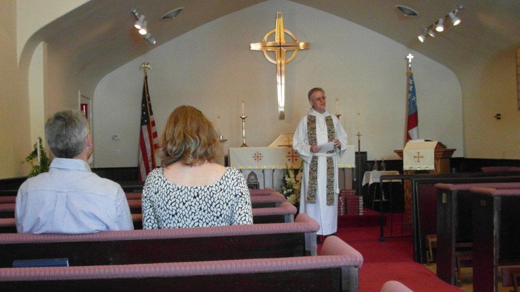 Father John gives a sermon.